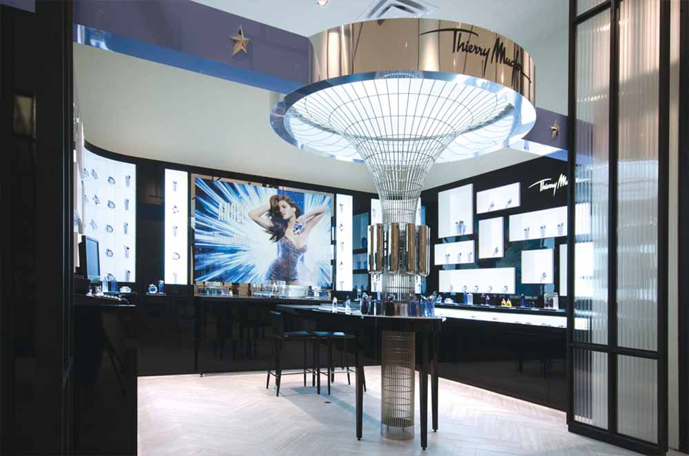 Complete Retail Environment Composed of Display Modules and Custom-Made Wire Tower Holding a Large Circular Structure With the Thierry Mugler Logo At Top