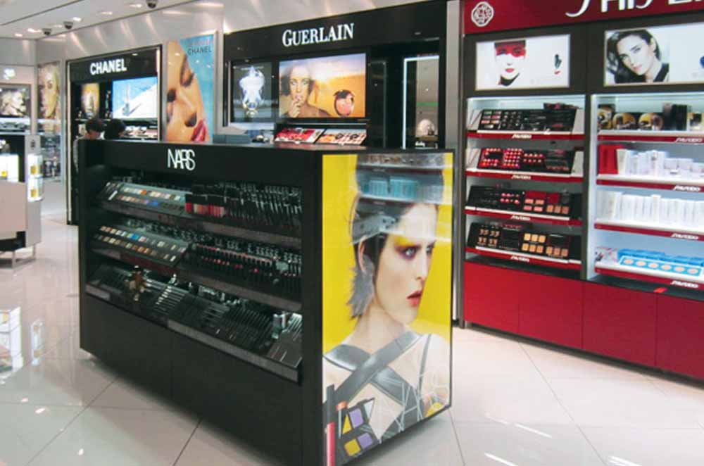 Image of Open Service System With Three Levels of Shelves for Makeup Display - Designed and Manufactured for NARS
