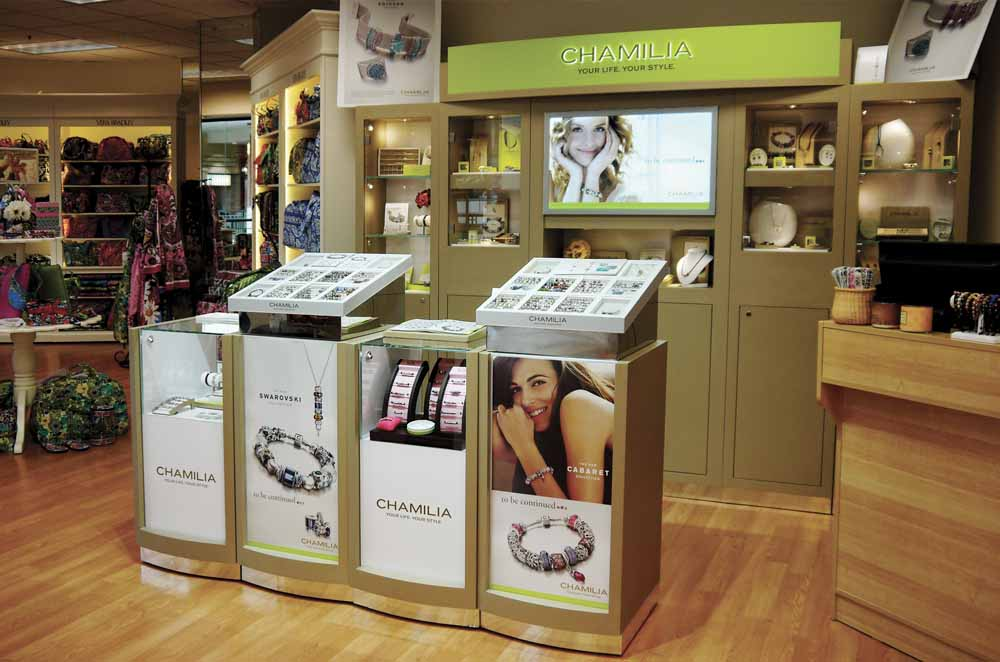 Merchandising Modules With Logo Banners and Counter Top display Units for Product Display - Designed and Manufactured for Chamilia